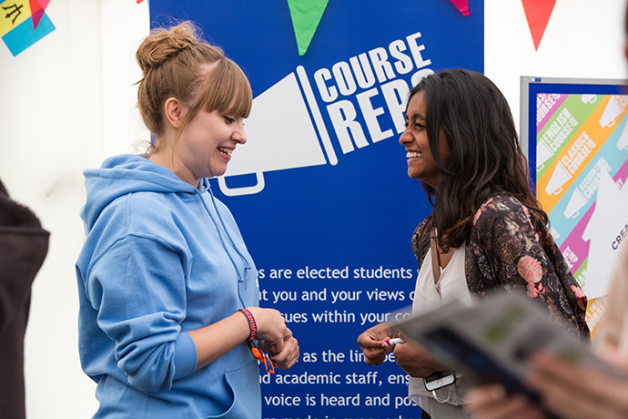 A senior rep helping a student at a RUSU open day